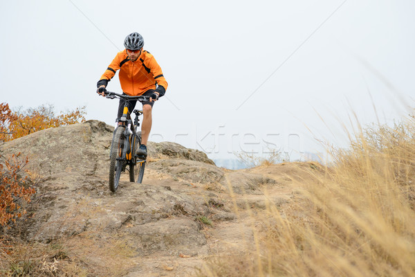 Cyclist Riding Bike on the Beautiful Autumn Mountain Trail Stock photo © maxpro