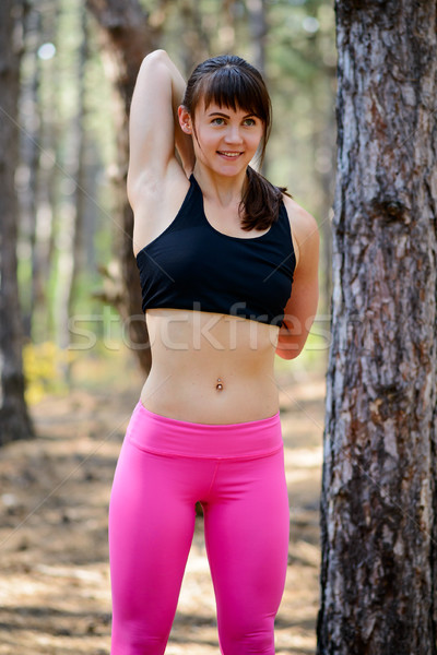 Young Fitness Woman Stretching in the Pine Forest. Female Runner Doing Stretches . Healthy Lifestyle Stock photo © maxpro