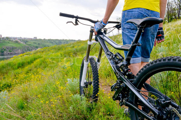 Stock photo: Cyclist and his Bike on Beautiful Spring Mountain Trail