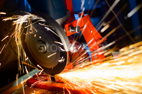 Stock photo: Elactric Grinder Cutting Metal with Bright Sparks