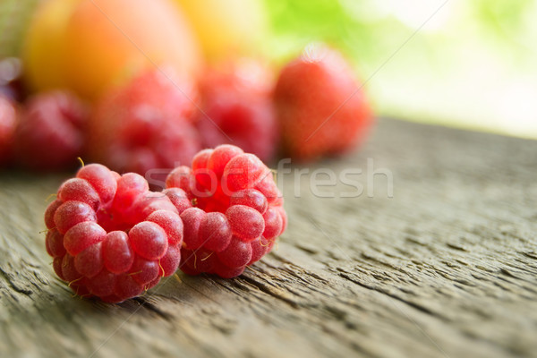 Stock photo: Ripe Sweet Raspberries and Fruits on the Wooden Table