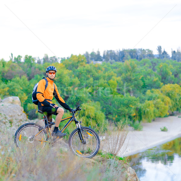 Cyclist with Bike in the Beautiful Mountains Stock photo © maxpro