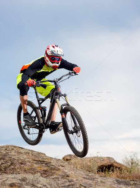 Professional Cyclist Riding the Bike Down Rocky Hill. Extreme Sport Concept. Stock photo © maxpro