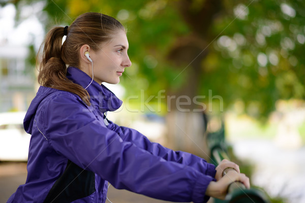 Stock photo: Young Beautiful Fit Woman Exercising in the Park