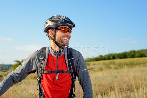 Stock photo: Portrait of Young Cyclist in Helmet and Glasses