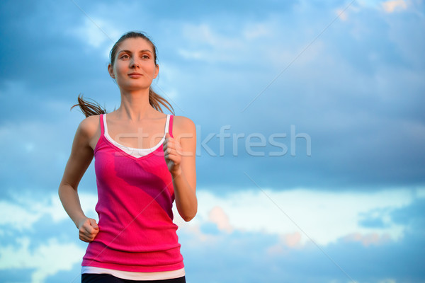 Stock photo: Young Beautiful Woman Running on the Mountain Trail in the Morni