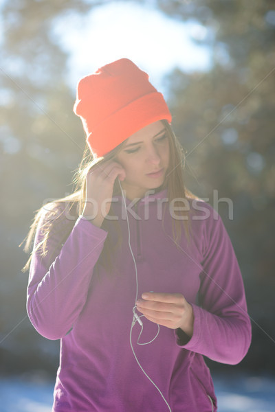 Young Woman Prepairing for Running in Beautiful Winter Forest at Sunny Frosty Day. Active Lifestyle  Stock photo © maxpro