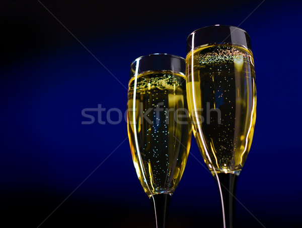 Two Glasses of Champagne on Dark Blue Background Stock photo © maxpro