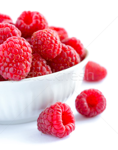 Stock photo: Big Pile of Fresh Raspberries in the White Bowl Isolated on White Background