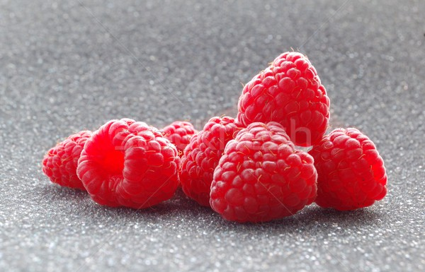 Closeup image of Fresh Raspberries on the Dark Background Stock photo © maxpro