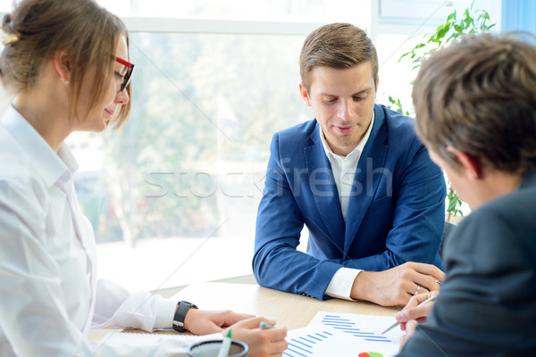 Business People Analyzing Financial Results on Graphs around the Table in Modern Office. Team Work C Stock photo © maxpro