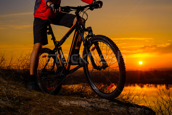 Enduro Cyclist Riding the Mountain Bike on the Rocky Trail at Sunset. Active Lifestyle Concept. Stock photo © maxpro