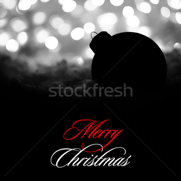 Mysterious Christmas Decoration with Black Ball in the Snow on the Background of White Blurred Holid Stock photo © maxpro