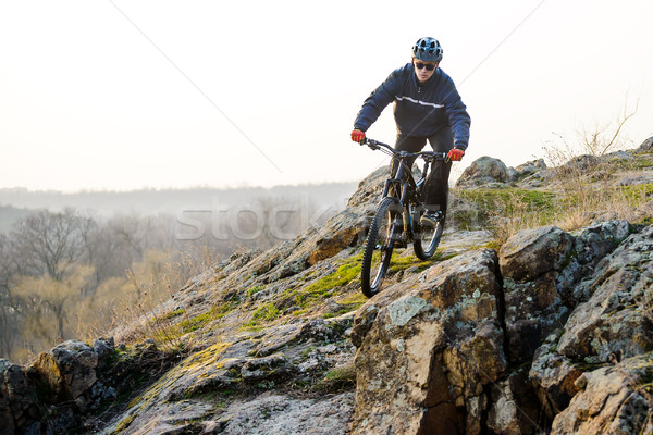 Enduro Cyclist Riding the Mountain Bike Down Beautiful Rocky Trail. Extreme Sport Concept. Space for Stock photo © maxpro