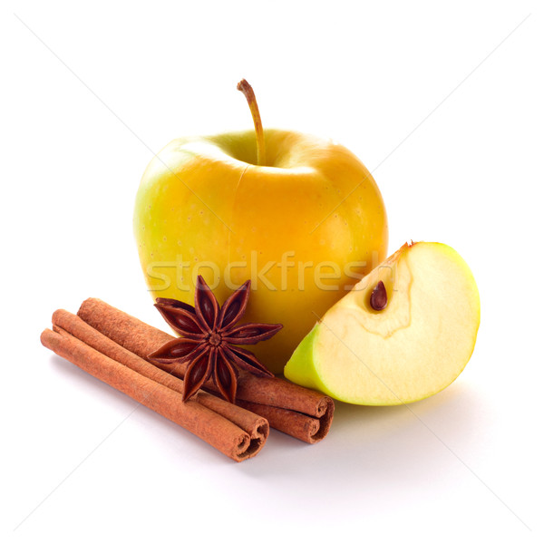 Stock photo: Yellow Apple with Apple Slice, Cinnamon Sticks and Anise on the