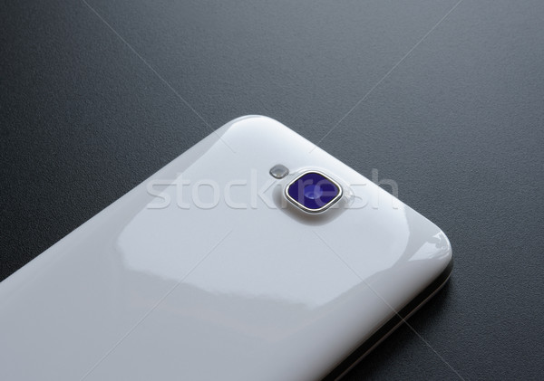 Close Up Image of the Camera of White Smart Phone on the Black Table Stock photo © maxpro