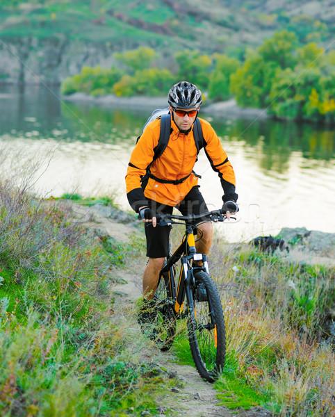 Cyclist Riding the Bike on the Beautiful Mountain Trail Stock photo © maxpro