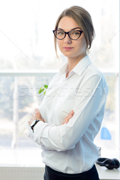 Young Attractive Smiling Businesswoman in White in Bright Modern Office Stock photo © maxpro