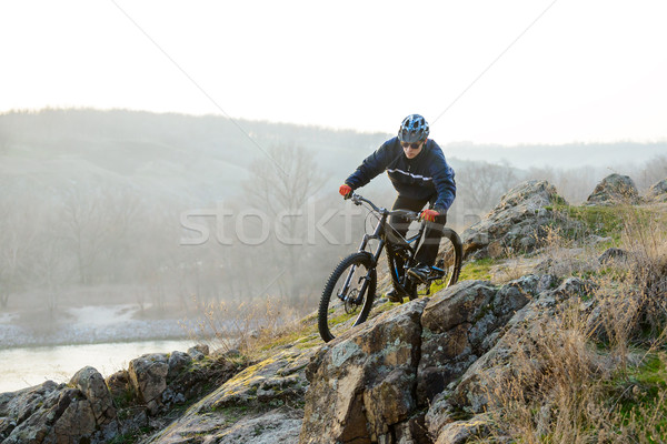Stock photo: Enduro Cyclist Riding the Mountain Bike Down Beautiful Rocky Trail. Extreme Sport Concept. Space for