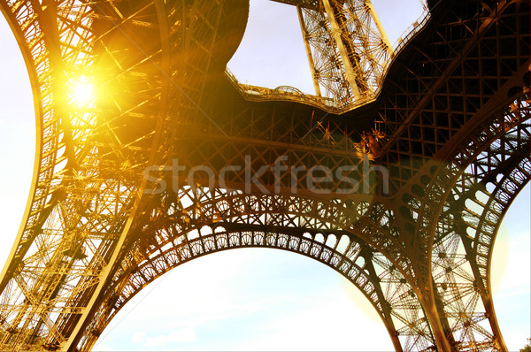 Paris, Eiffel Tower with Bright Sun. Wide Angle View from Below Stock photo © maxpro