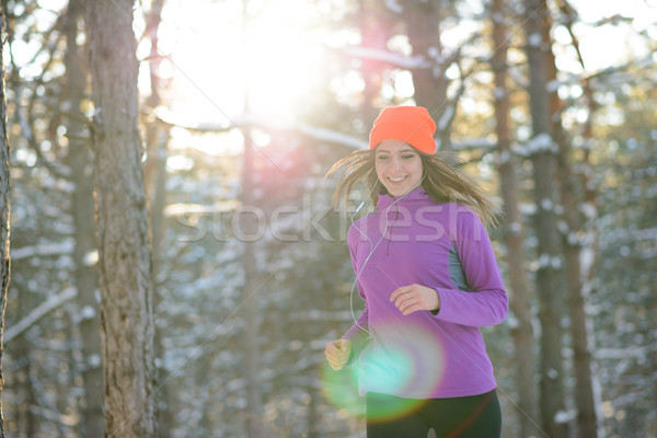 Young Woman Running in Beautiful Winter Forest at Sunny Frosty Day. Active Lifestyle Concept. Stock photo © maxpro