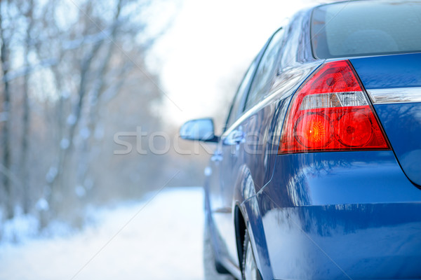 Stock photo: Blue Car on the Winter Snowy Road. Close up Rear View. Travel and Drive Safe Concept.
