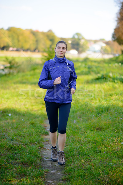 Young Beautiful Woman Running in the Park Stock photo © maxpro