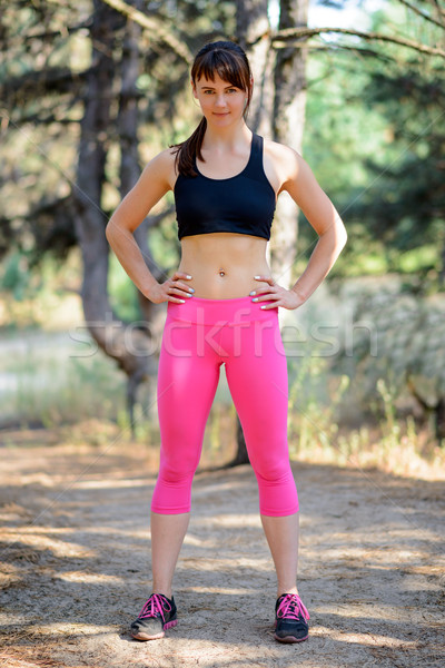 Portrait of Young Female Runner in Beautiful Wild Pine Forest. Active Lifestyle Concept. Stock photo © maxpro
