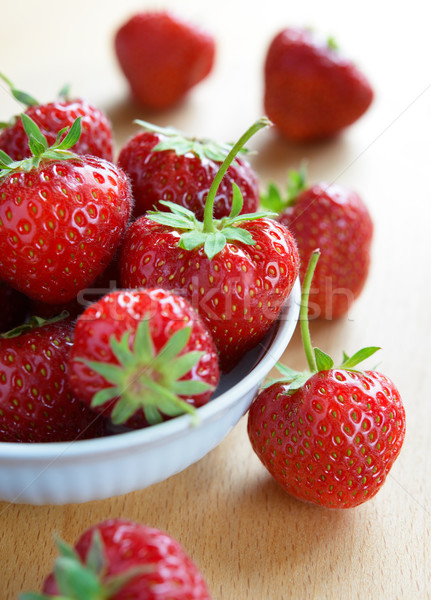 Ripe Juicy Strawberries in the White Bowl on the Wooden Table Stock photo © maxpro