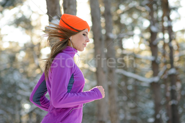 Stock photo: Young Woman Running in Beautiful Winter Forest at Sunny Frosty Day. Active Lifestyle Concept.