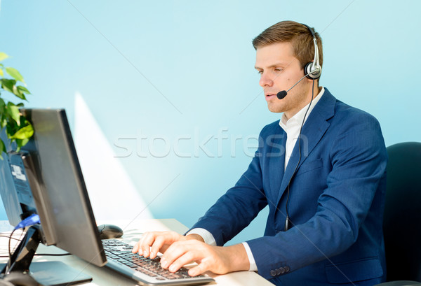 Young Customer Support Phone Operator with Headset Working in the Office. Stock photo © maxpro