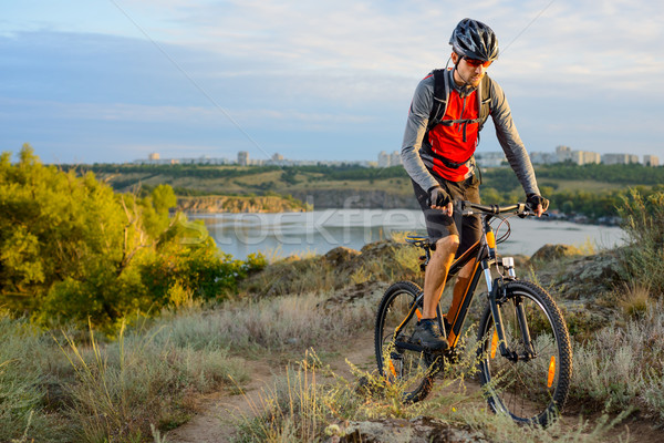 Cyclist Riding the Bike on the Beautiful Spring Mountain Trail Stock photo © maxpro