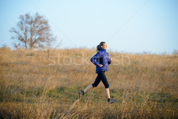 Young Sports Woman Running on the Trail in the Autumn Field Stock photo © maxpro