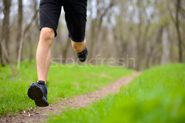 Stock photo: Young Sportsman Running on the Spring Forest Trail in Morning. Legs Close up View