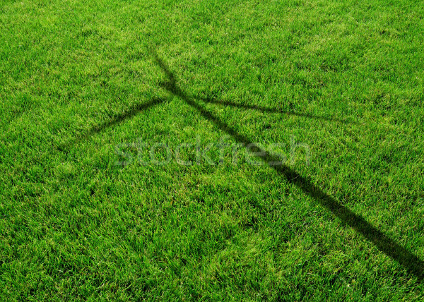 Wind Generator Turbine Shadow on the Grass Stock photo © maxpro