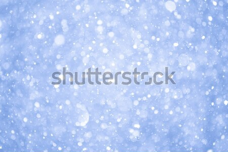 Stock photo: Abstract Blue Christmas Background with Real Snow. Blurred Snowflakes.