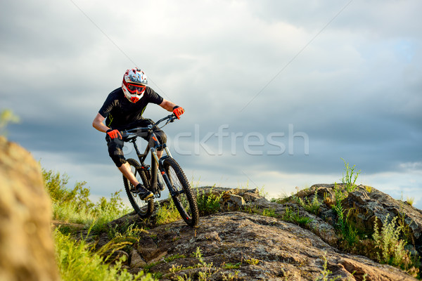 Professional Cyclist Riding the Bike on the Rocky Trail. Extreme Sport. Stock photo © maxpro