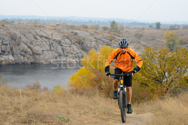 Stock photo: Cyclist Riding Bike on the Beautiful Autumn Mountain Trail under River