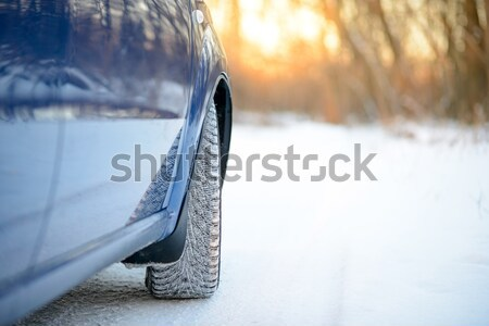 Stock photo: Close up Image of Side Rear-view Mirror on a Car in the Winter Landscape with Evening Sun