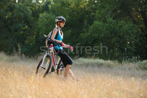 Young Attractive Woman Resting with Bike in the Beautiful Forest Stock photo © maxpro