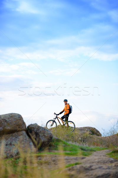 Stock photo: Cyclist with Bike in the Beautiful Mountains