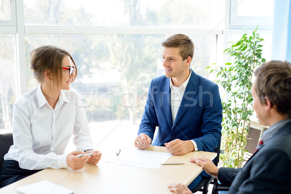 Business People Analyzing Financial Results around the Table in Modern Office. Team Work Concept Stock photo © maxpro