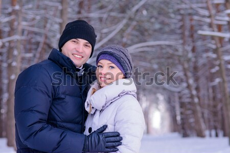 Portrait of a Young Smiling Couple Lying on the Snow Stock photo © maxpro