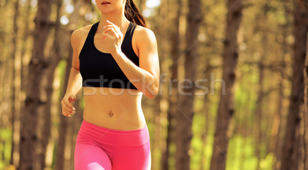Stock photo: Young Woman Running on the Trail in the Beautiful Wild Pine Forest. Active Lifestyle Concept. Space