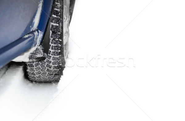 Stock photo: Close-up Image of Winter Car Tire on Snowy Road with Space for Your Text. Drive Safe Concept