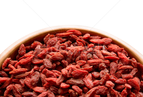 Wooden Bowl Full of Dried Goji Berries on the White Table Stock photo © maxpro