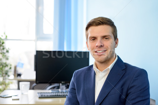Young Smiling Attractive Businessman in Blue Suit at Modern Office. Business Concept Stock photo © maxpro