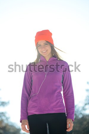 Young Woman Runner Smiling in Beautiful Winter Forest at Sunny Frosty Day. Active Lifestyle and Spor Stock photo © maxpro