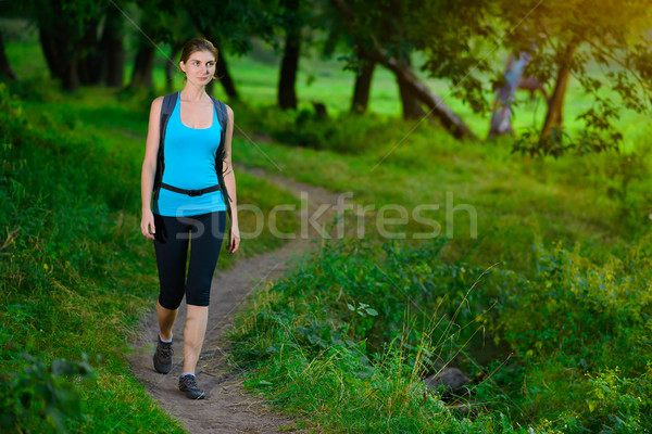 Young Beautiful Woman Hiking in the Green Summer Forest Stock photo © maxpro