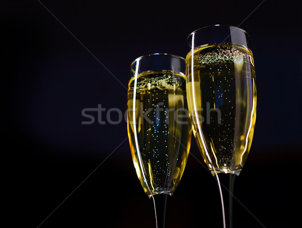 Two Glasses of Champagne against Dark Background Stock photo © maxpro